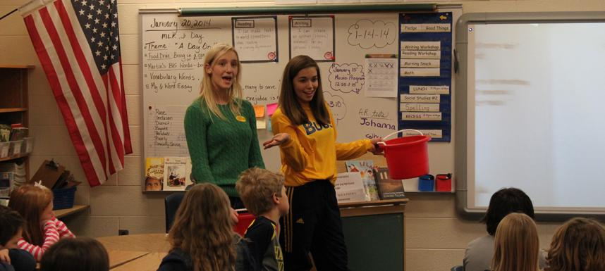 """Mattson and Harding act out """"How Full is Your Bucket"""" by Tom Rath and Mary Reckmeyer to Barb Andres third-grade class at Rosy Mound elementary."""